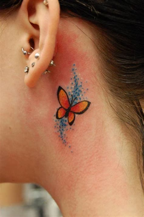this tiny butterfly tattoo is pretty cute hiding behind