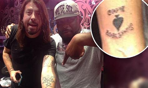 dave grohl tattoo removal foo fighter s dave grohl unveils ace of spades