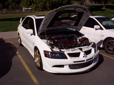 white mitsubishi lancer with black rims white evo with gold or black rims evolutionm