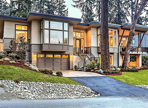 front sloping lot house plans modern for front sloping lot 23556jd architectural designs house plans