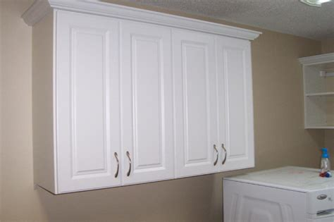 Laundry Room Storage Cabinets Ideas White Raiised Panel Utility Cabinets Laundry Room
