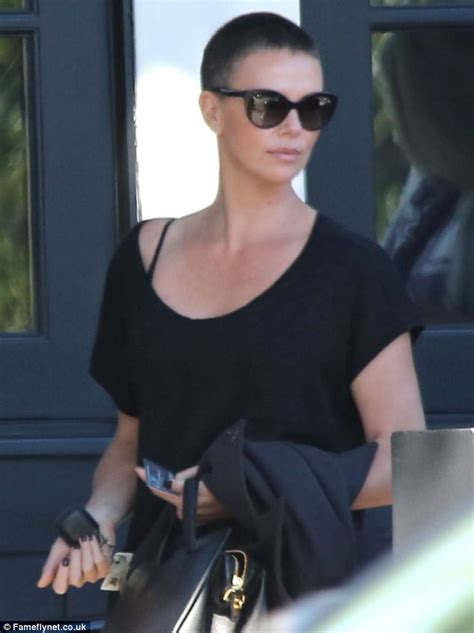 Charlize Therons White Poofy Number by Charlize Theron Bravely Steps Out After New Buzz Cut