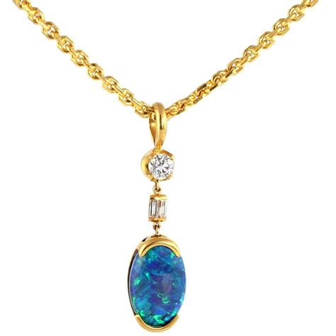 black chain with pendant 22kt gold and black opal pendant with 22kt gold