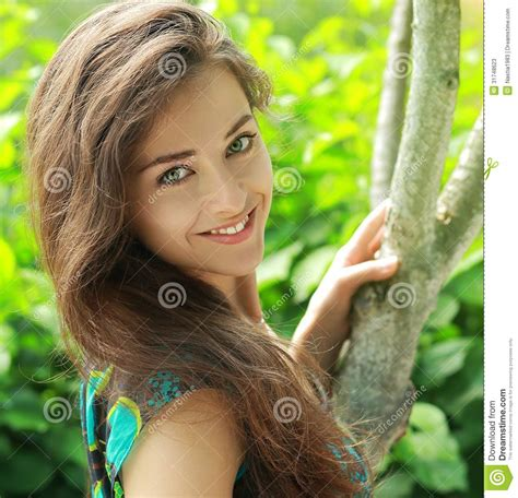 beautiful woman by the tree looking up stock photo image beautiful lady near the tree stock photos image 31748623