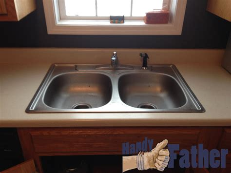 replacing kitchen sink how to replace an old kitchen sink handy father