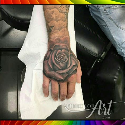 rose tattoo hand tatoo
