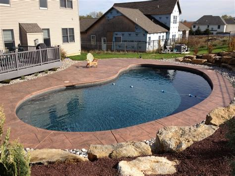forks township kidney shape pool with boulder retaining