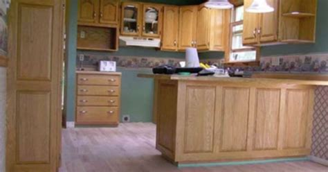 Kitchen Painting Ideas With Oak Cabinets by Dated Oak Cabinets To White And Fresh Before Amp After