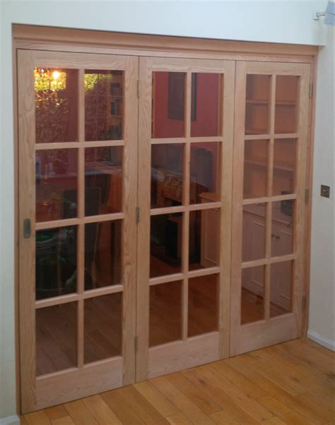 Tri Fold Interior Doors Douglas Fir Tri Fold Glazed Doors From Sjs Surrey Joinery Specialists Joinery And