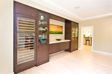 dining room built in with wine refrigerator ceiling detail