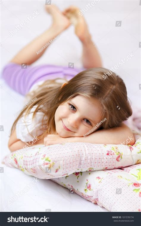 girls in bed cute little girl pajamas on bed stock photo 101578174