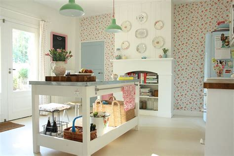 wallpaper brings a vintage charm to the cool shabby chic kitchen in white from holly marder