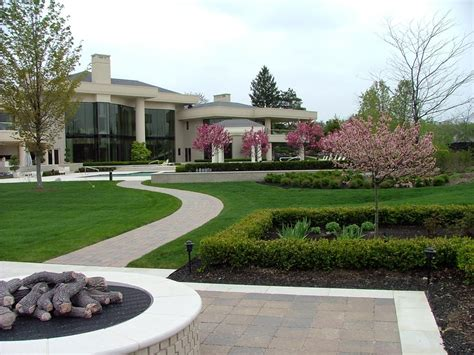 limestone fire pit and patio leading to landscaped home