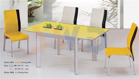 dainty dining room with modern table and yellow chair