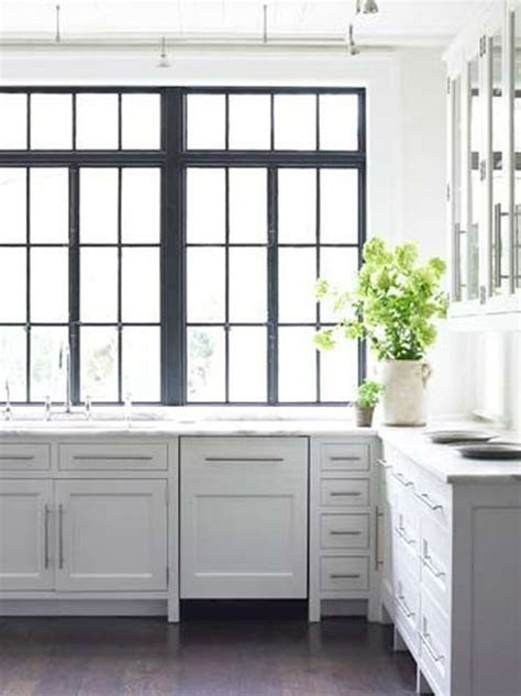 kitchen cabinets with windows lightest grey cabinets brass pulls white counters dark