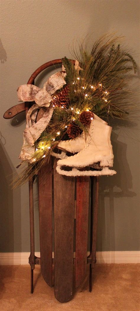 decorate old sled for the holidays christmas pinterest