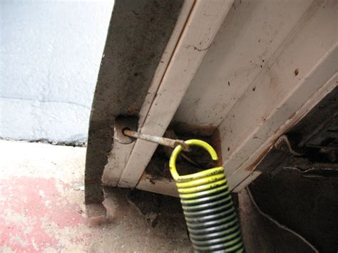 Garage Door Springs Diy Repairs One Garage Door Extension Replacement