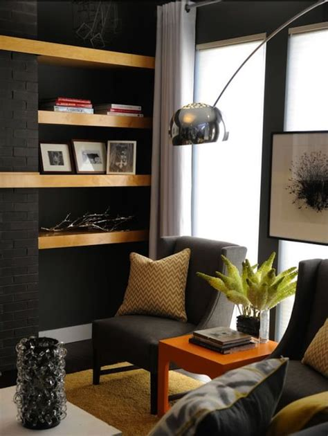 charcoal grey living room charcoal gray walls paint color charcoal gray wingback modern chairs yellow chevron pillows