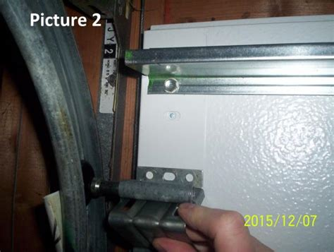 garage door adjustment do it yourself broken top panel on a 16 ft garage door doityourself