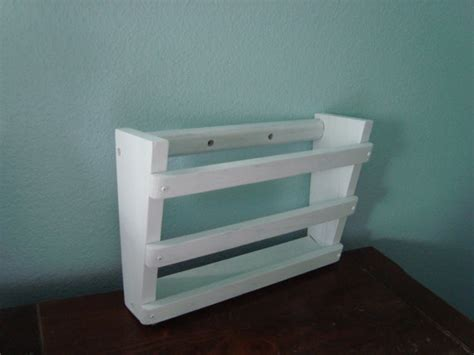 White Wall Magazine Rack white wall hanging wood magazine rack