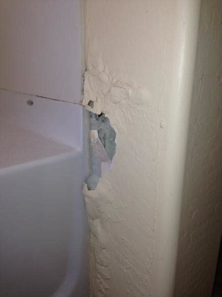 bathroom wall repair repairing damaged drywall section adjacent to shower