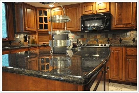 uba tuba granite with oak cabinets what color granite goes with oak cabinets askhomedesign com