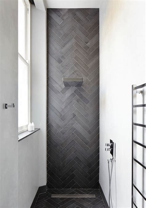 contemporary shower featuring herringbone tile decoist