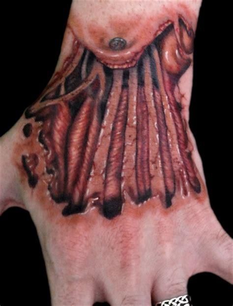 finger tattoo tear skin tear hand by timothy b boor tattoonow