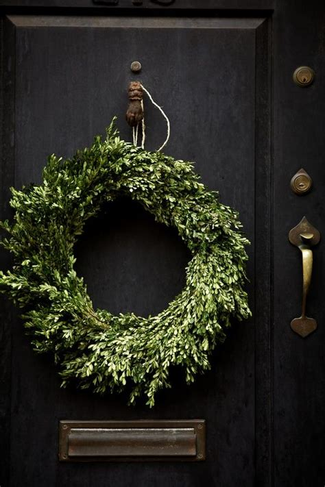 black front door with boxwood wreath home decorating