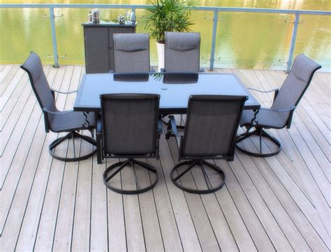 Swivel Rocker Patio Dining Sets Pebble Living 7 Patio Dining Set With Cast Aluminum Table And Swivel Rocker Chairs