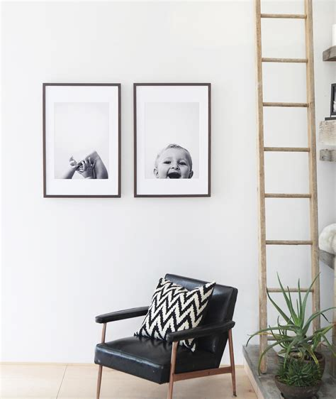 sticking frames to walls without nails picture hanging ideas