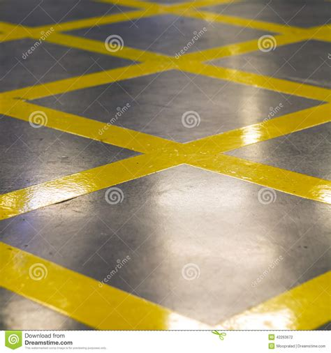 pattern of yellow lines on the roadway cross yellow stripes of no parking symbol on road stock