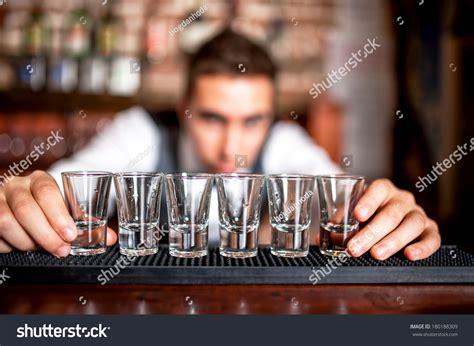 bartender photography bartender preparing lining shot glasses alcoholic stock