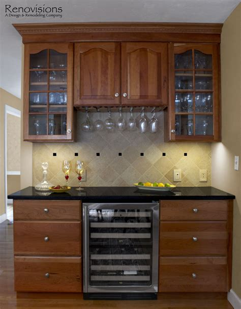 cherry cabinets with granite countertops kitchen remodel by renovisions decorative tan and black