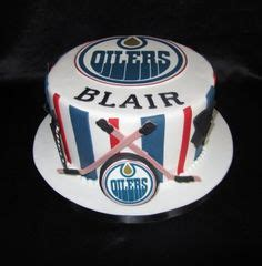 themed birthday cakes edmonton oilers cake with jersey hockey puck and stick maxs bday