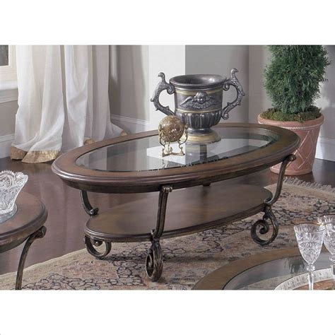 riverside fortunado oval coffee table in distressed cherry