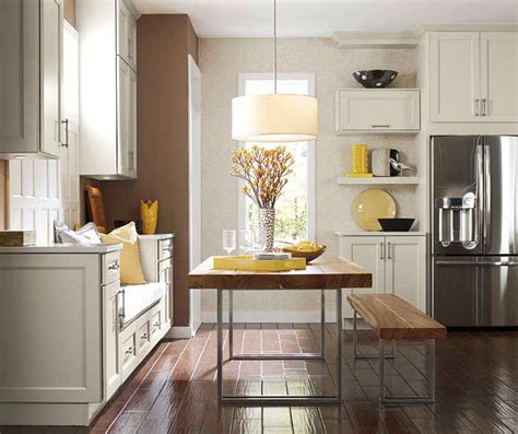 kitchen wall cabinets casual cottage off white cabinets in casual kitchen diamond cabinetry