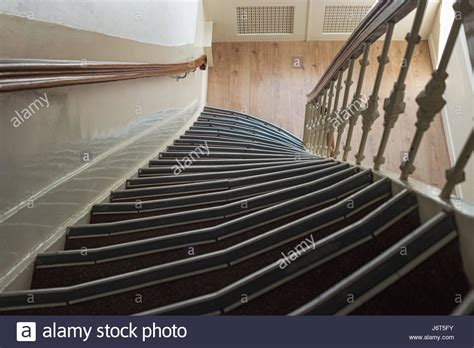 narrow staircase railing stock photos narrow staircase