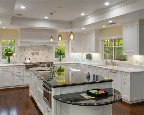 white kitchen island with granite countertop and prep sink photo page hgtv