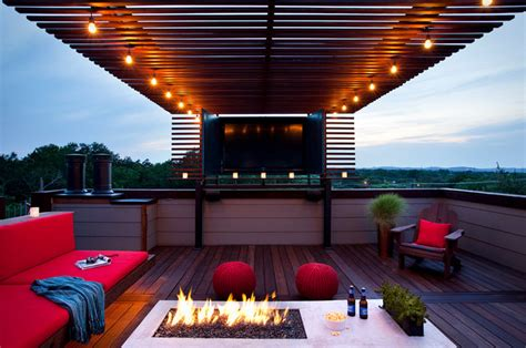rooftop outdoor living with a TV and fire Modern Patio austin by austin outdoor design