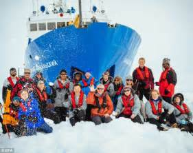 iced in ten days trapped on the edge of antarctica books stranded antarctic crew pictured with penguins and