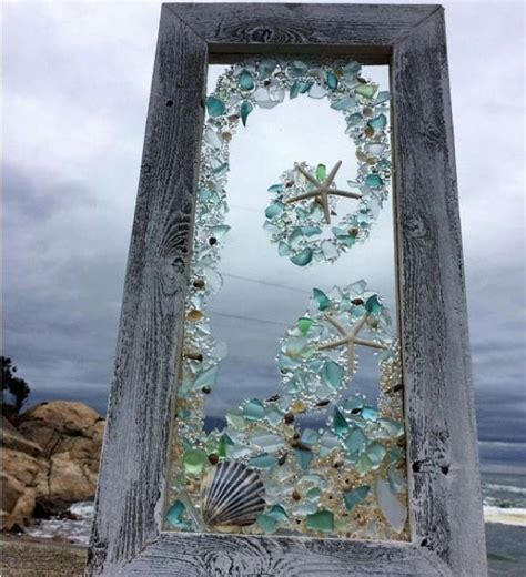 sea glass and shells on an old window beautiful
