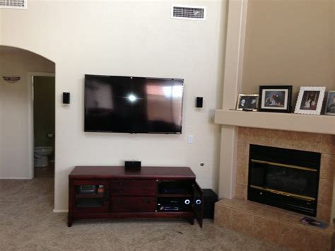 tv in corner of room surround sound 5 1 surround sound with tv mount and wire concealment traditional living room by
