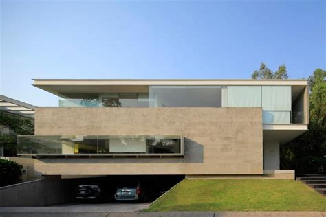 geometric home has cantilevered master suite overlooking