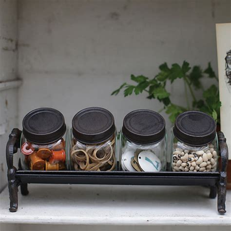 decorative glass jars with cast iron rack rustic