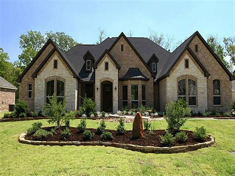 houses with brick and stucco exteriors all house home
