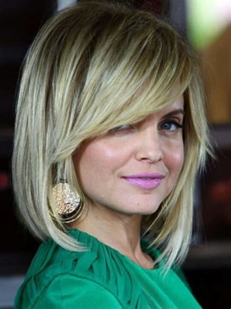 long hair cut at an angle on sides i think i might try this long bob with side bangs