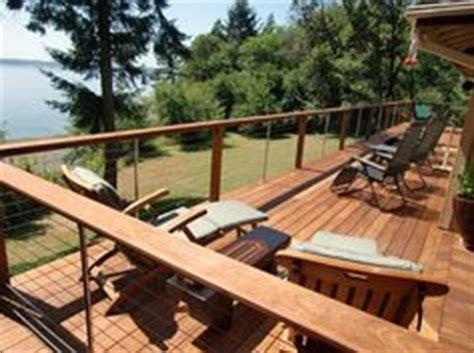 deck railing bar top deck and under deck storage on pinterest satellite dish deck furniture and deck
