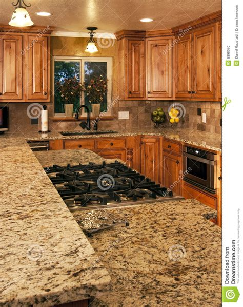 what are two cabinet level new kitchen two level center island stock photo image