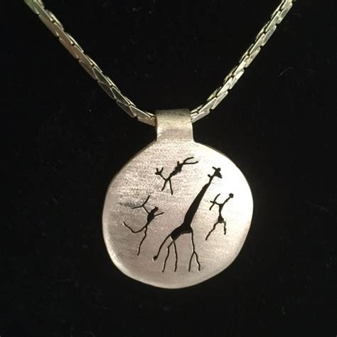 ra the rugged chains rugged 4 fig gold pendant safari gold